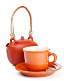 Clay kettle and cup with saucer Royalty Free Stock Photos