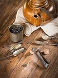 Clay kettle, dry black tea Stock Photography
