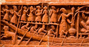 Sculptures stock image. Beautiful clay made human figures on a boat background photograph royalty free stock photography