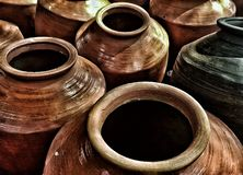 Clay made pots used as a container royalty free stock photography