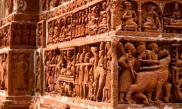 Sculptures wall handmade stock. Beautiful handmade figures with clay and natural colours captured from an ancient temple around Bangladesh stock photos