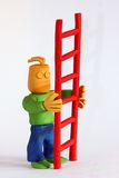Clay Man Holds Ladder Royalty Free Stock Image