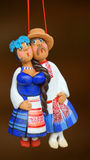 Clay man and woman figures. Clay man and woman toy in national costumes stock photo
