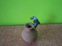 The clay model of thirsty crow. stock photography
