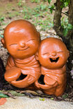 Clay Monk Happy Statues fotografia stock