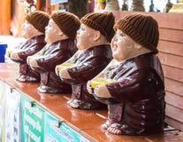 Clay Monk Happy Statues, Thai style Stock Photo