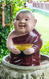 Clay Monk Happy Statues, Thai style Stock Image