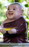 Clay Monk Happy Statues, Thai style Royalty Free Stock Photos