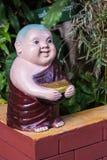 Clay Monk Happy Statues, Thai style Stock Photos