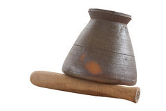 Clay mortar and wooden pestle Royalty Free Stock Photos