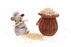 The clay mouse with a basket of rice. On a white background Royalty Free Stock Photos