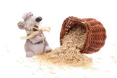 The clay mouse with a basket of rice. On a white background Stock Photos