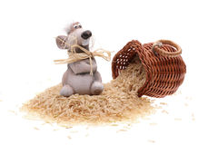 The clay mouse with a basket of rice. On a white background Royalty Free Stock Image