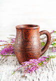 Clay mug and heather Stock Photos