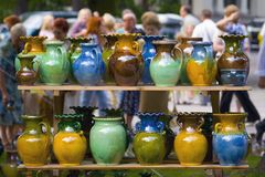Clay mugs for sale in a summer fair Royalty Free Stock Photo