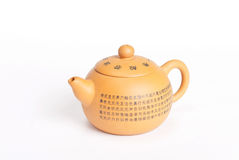 Clay orange teapot with chinese calligraphy Royalty Free Stock Images
