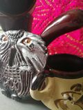 Clay owl on the background of coffee dishes stock photography