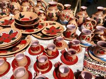 Painted cups and jugs at open air market stock photo