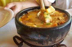 Clay pan with seafood stock photos
