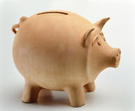 Clay Piggy Bank. Natural Clay Piggy Bank on neutral background Stock Photo