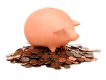 Clay piggy bank on a pile of European cents Royalty Free Stock Image