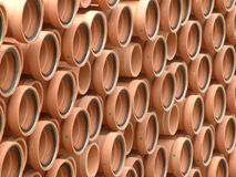 Clay Pipes. Stocks of large clay pipes stacked at factory compound Stock Photography