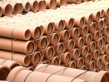 Clay Pipes. Stocks of large clay pipes stacked at factory compound Stock Photo