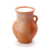 Clay pitcher filled with milk Royalty Free Stock Photos