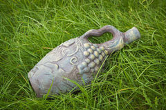 Clay pitcher on the lawn. Stock Photo