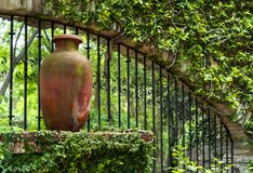 Clay pitcher pot and metal bars in colonial mexican garden. In San Gabriel Barrera Guanajuato royalty free stock images
