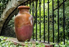 Clay pitcher pot and metal bars in colonial mexican garden. In San Gabriel Barrera Guanajuato royalty free stock image