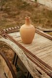 Clay Pitcher On Wooden Cartload Outdoors stock photography