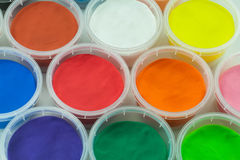 Clay or plasticine in cup colorful background Royalty Free Stock Photo