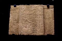 Clay plate with Egyptian hieroglyphs. Royalty Free Stock Photo