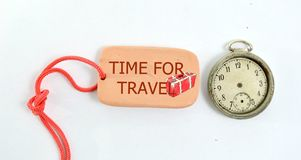 Clay plate and vintage clock with text time to travel. Image of a clay plate and vintage clock with text time to travel stock photo