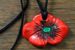 Clay poppy pendent handmade Royalty Free Stock Photos