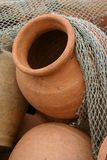 Clay pot. A clay pot with some fishing nets over them stock images
