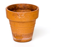 Clay Pot. A terracotta clay pot for growing plants over a white background stock photography