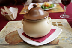 The clay pot. With meat in restaurant Stock Photography