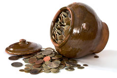 Clay pot with antique coins and lid Stock Photo