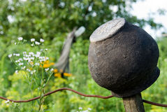 Clay pot on a background of grass and flowers Royalty Free Stock Image