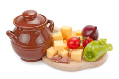 Clay pot ,cheese and vegetables on wooden board Royalty Free Stock Photos