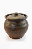 Clay pot closed. Dark clay pot closed with cover over white background Royalty Free Stock Image