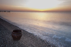 The clay pot on the coast, the sea and the beautiful sky Stock Images