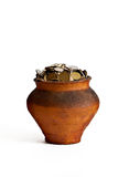 Clay pot with coins Royalty Free Stock Photos