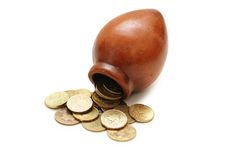 Clay pot and coins isolated Royalty Free Stock Photo