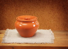 Clay pot for cooking and napkin Royalty Free Stock Photography
