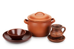 Clay pot and different ceramic tableware Royalty Free Stock Image