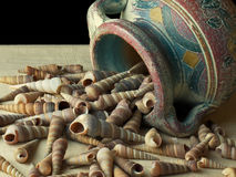 Clay pot dumping shells close up Stock Photo