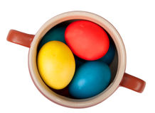 Clay pot with easter eggs isolated on white Stock Images